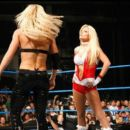 Krissy making her WWE Debut interfering in Victoria and Torrie Wilson's match on Smackdown 2007 - 443 x 392