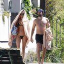 PICTURE EXCLUSIVE Irina Shayk displays her slender supermodel body in a black string bikini as she enjoys swim with shirtless hunky beau Bradley Cooper during romantic Lake Garda getaway - 454 x 530