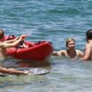 Jennette McCurdy wearing a pretty bikini and board shorts was spotted kayaking with a male friend in Maui