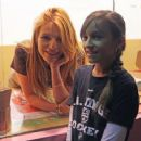 Bella Thorne works a shift at Sprinkles Cupcakes at The Grove in Los Angeles, California on December 18, 2014 - 454 x 373