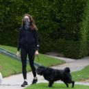Troian Bellisario – Out for a walk with her dog in Los Angeles - 454 x 479