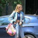 Stella Maxwell in Ripped Jeans out in Milan