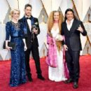 Producer Cara Speller, guest, Chloe Trujillo and musician Robert Trujillo attend the 89th Annual Academy Awards at Hollywood & Highland Center on February 26, 2017 in Hollywood, California. - 454 x 303