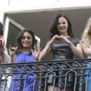Selena Gomez, Vanessa Hudgens, Rachel Korine, and Ashley Benson waving to their fans from their balcony at Bristol hotel in Paris, France, on February 17th 2013 - 454 x 275