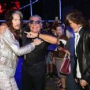 Steven Tyler, Roberto Cavalli and Joe Perry attend the Roberto Cavalli show during the Milan Menswear Fashion Week Spring Summer 2015 on June 24, 2014 in Milan, Italy. - 454 x 324
