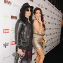Musician Slash and Perla Hudson attend the EMI Post-GRAMMY Party held at The Capitol Tower at Capitol Records Tower on February 12, 2012 in Los Angeles, California