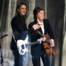 "Paul McCartney and guitarist Nuno Bettencourt perform ""FourFiveSeconds"" onstage during The 57th Annual GRAMMY Awards at the at the STAPLES Center on February 8, 2015 in Los Angeles, California."