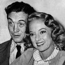 Evelyn Keyes and John Huston