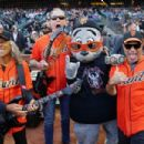 Metallica poses with the mascot Seal prior to the game between the San Francisco Giants and the New York Yankees at Oracle Park on April 26, 2019 in San Francisco, California