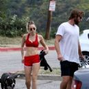 Miley Cyrus in Red Shorts and Sports Bra hiking in LA - 454 x 682