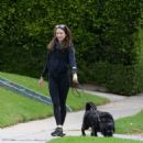 Troian Bellisario – Out for a walk with her dog in Los Angeles - 454 x 492