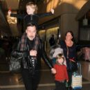 David Furnish, Zachary Jackson Levon Furnish John, and Elijah Joseph Daniel Furnish John are seen at LAX
