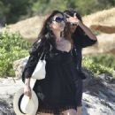 Catherine Zeta-Jones shows off her legs in pretty black dress for a relaxing beach day with Michael Douglas as their sun-soaked holiday in Sardinia continues