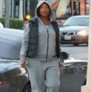 Queen Latifah makes a quick stop by a liquor store to pick up some milk in West Hollywood, California on December 23, 2013