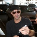 Chris Martin seen at LAX - 396 x 594
