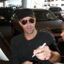 Chris Martin seen at LAX