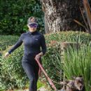 Reese Witherspoon – Out for a jog with her two dogs in Santa Monica