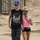Actress Ashley Tisdale and her boyfriend Christopher French going for an afternoon hike at Runyon Canyon in Los Angeles, California on July 20, 2013