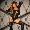 Carmen Electra poses for sexy calendar shoot at Bootsy Bellows night club