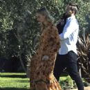 Margot Robbie in Long Dress With Her Dog in LA