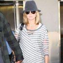 Heidi Klum And Seal Arriving On A Flight At LAX