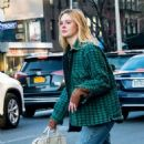 Elle Fanning catches a taxi in NYC