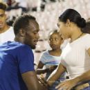 'My babbbbbbbbbbbyyyyyyyyyyy!!!': Usain Bolt's girlfriend can't control her delight as she cheers him on to an eighth gold medal and star poses for biggest ever fan selfie - 454 x 331