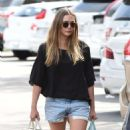 Elizabeth Olsen in Shorts at grocery shopping in Los Angeles