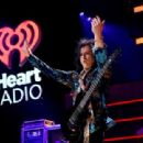 Recording artist Steve Stevens performs onstage during the first ever iHeart80s Party at The Forum on February 20, 2016 in Inglewood, California. - 454 x 311