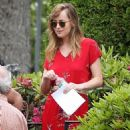 Dakota Johnson on the set of Black Mass with Johnny Depp. (June 10, 2014)