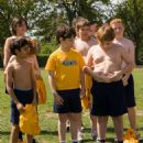 Rowley Jefferson (Robert Capron, left) explores the wonders of his belly button, as classmates Greg Heffley (Zachary Gordon, center) and Chirag Gupta (Karan Brar) look on. Photo credit: Rob McEwan - 454 x 557