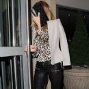 Rosie Huntington Whiteley returning to her hotel after having dinner at Little House Mayfair restaurant in London (September 17)
