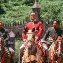 Chow Yun-Fat, flanked by royal bodyguards, in 20th Century Fox's Anna And The King - 12/99 - 350 x 235
