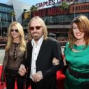 Tom Petty, center, wife Dana York, right, and daughter Adria Petty arrive at the MTV Video Music Awards