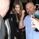 Gigi Hadid and singer Zayn Malik try to leave their hotel in New York City are are mobbed by fans and security shining flashlights April 1, 2016