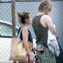 Couple Emma Roberts and Evan Peters leaving a pool together in New Orleans, Louisiana on October 15, 2013 - 430 x 594