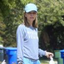 Calista Flockhart with her dogs out in Brentwood
