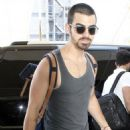Joe Jonas prep up at LAX Airport before heading out of Los Angeles