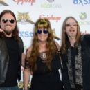 Rex Brown Rita Haney, Mark Zavon arrive at the 5th Annual Revolver Golden Gods Award Show at Club Nokia on May 2, 2013 in Los Angeles, California. - 454 x 297