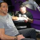 Shawn getting tattooed at Shannon Moore's tattoo shop Gas Chamber Ink.