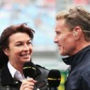 BBC F1 presenter Suzi Perry talks with former F1 driver David Coulthard in the paddock during the weather delayed qualifying session for the Australian Formula One Grand Prix at the Albert Park Circuit on March 17, 2013 in Melbourne, Australia