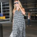 Heidi Klum and her boyfriend touch down at LAX airport in Los Angeles, Califronia on July 31, 2016 - 393 x 600