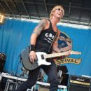 Duff McKagan performs at the 2012 CBGB Festival on July 7, 2012 in New York City - 399 x 594