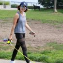 Lucy Hale–Takes her dog Elvis on a walk in Vancouver - 454 x 574