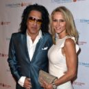 Musician Paul Stanley of KISS and Erin Sutton attend the Spirit of Excellence Awards 2014 at the Hyatt Regency Century Plaza on September 23, 2014 in Century City, California - 405 x 594