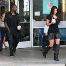 Kim Kardashian and Kanye West getting frozen yogurt at Yogurtland in Hawaii (August 16)