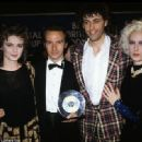 Annabel Giles, Midge Ure, Bob Geldof and Paula Yates with a special award for Band Aid at the 1985 Brit Awards