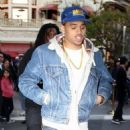Chris Brown catches a Christmas Eve movie at The Grove shopping center on Saturday (December 24) in Los Angeles