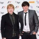 Rupert Grint attended the F1 Party today, July 4, in London. Rupert attended the event with his brother James - 454 x 575