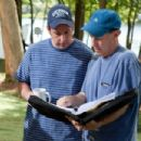 Adam Sandler and director Dennis Dugan on the set of Columbia Pictures' GROWN UPS. Photo By: Tracy Bennett. ©2009 Columbia TriStar Marketing Group, Inc. All Rights Reserved. - 454 x 303